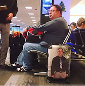 passenger places his own face on suitcase