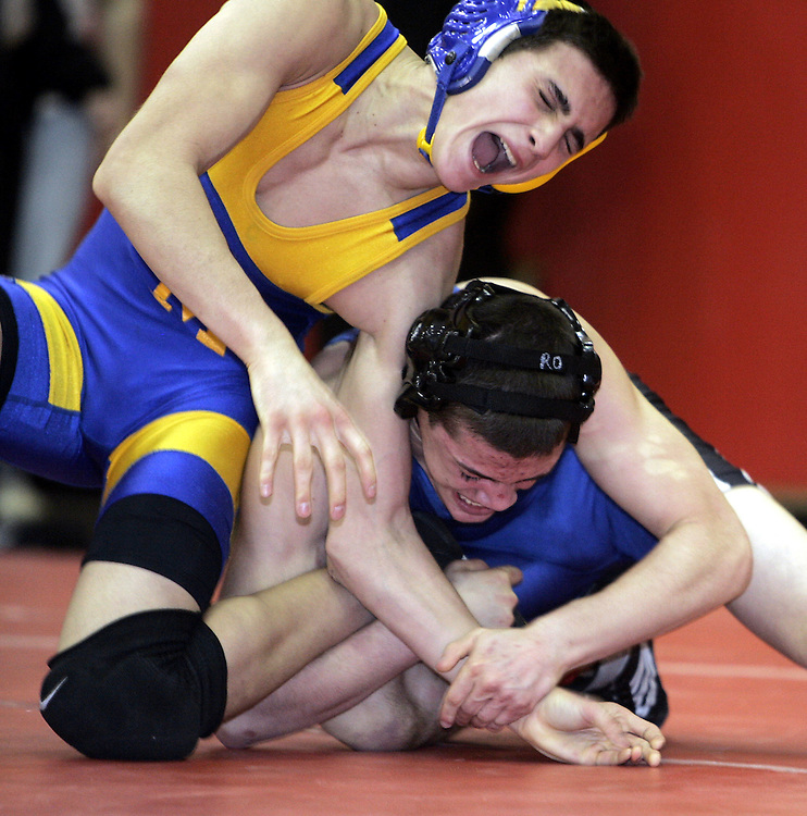 North Salem's Ryan Osleeb, right, and East Meadow's Nick Falco wrestle in the 119lb weight division during the finals of a varsity wrestling tournament at Somers High School Jan. 3, 2009. ( Mike Roy / The Journal News )