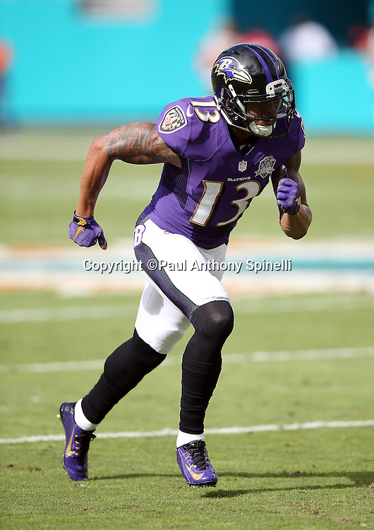 Baltimore Ravens wide receiver Chris Givens (13) goes out for a pass during the 2015 week 13 regular season NFL football game against the Miami Dolphins on Sunday, Dec. 6, 2015 in Miami Gardens, Fla. The Dolphins won the game 15-13. (©Paul Anthony Spinelli)