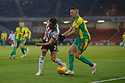 Sheffield United defender George Baldock (2) clears from West Bromwich Albion defender Kieran Gibbs (3)  during the EFL Sky Bet Championship match between Sheffield United and West Bromwich Albion at Bramall Lane, Sheffield, England on 14 December 2018.