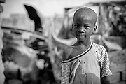 Five year old Malian boy Omar Djibo poses for a photograph in the street in which he lives in Diabaly, Mali 26 January 2013. This photograph is part of a picture package of portraits showing children living along the same street in the small rice growing community of the northern Malian town of Diabaly who in the month of January 2013 lived through a rapid chain of events in the Malian war.