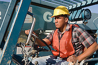 Construction worker driving vehicle