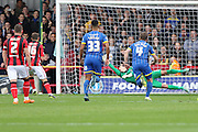 Shaun Miller equalises for Morecambe on 8 minutes from the spot.  during the Sky Bet League 2 match between AFC Wimbledon and Morecambe at the Cherry Red Records Stadium, Kingston, England on 17 October 2015. Photo by Stuart Butcher.