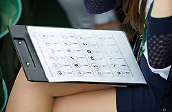 LONDON, ENGLAND - Wednesday, June 25, 2014: A Wimbledon official checks the branding of the players against an officially approved list during the Ladies' Doubles 1st Round match on day three of the Wimbledon Lawn Tennis Championships at the All England Lawn Tennis and Croquet Club. (Pic by David Rawcliffe/Propaganda)