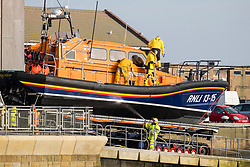 The RNLB Frederick William Plaxton, a Shanon Class Lifeboat, is recovered by her launch and recovery tractor from South Beach Scarborough and returned to the towns Lifeboat house<br />