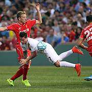 Lucas Leiva, (left), Liverpool, challenges Juan Manuel Iturbe, AS Roma, during the Liverpool Vs AS Roma friendly pre season football match at Fenway Park, Boston. USA. 23rd July 2014. Photo Tim Clayton