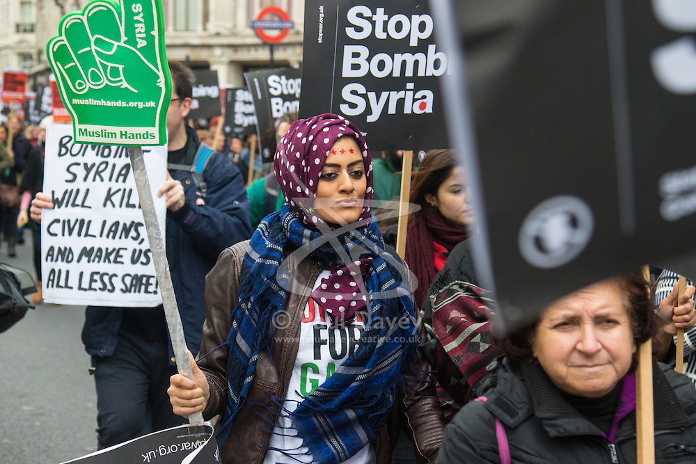 Regent Street, London, December 12th 2015. As British jets continue to strike strategic Islamic State/Daesh targets in Syria, thousands of anti-war protesters march in a Stop The War Coalition national demonstration calling for an immediate end to the bombing, and claiming that it will not deliver peace but will heighten the conflict in the Middle East and lead to further radicalisation of some Muslims both in the UK and abroad. ///FOR LICENCING CONTACT: paul@pauldaveycreative.co.uk TEL:+44 (0) 7966 016 296 or +44 (0) 20 8969 6875. ©2015 Paul R Davey. All rights reserved.