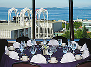 From the Space Needle's 100-foot SkyLine Level banquet room, see Puget Sound, the Olympic Mountains, and the arches of the Pacific Science Center, at Seattle Center, Washington, USA.