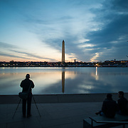 Photographers line up along the waterfront of the Tidal Basin before sunrise during the peak bloom of the famous cherry blossoms.