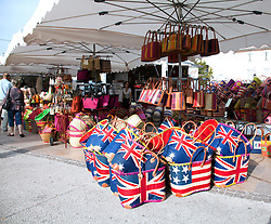Need a tote?  Some with a distinct British touch dominate a handbag stall.  Bags of all sorts, vintage clothing, toys, and antiques share sidewalk space with amazing food and working artists during the Sunday flea markets for which the town of L'Isle-sur-la-Sorgue is famous.