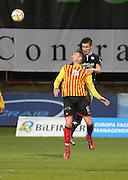 Dundee's Thomas Konrad outjumps Partick Thistle's Ryan Stevenson- Partick Thistle v Dundee - SPFL Premiership at Dens Park<br /> <br />  - &copy; David Young - www.davidyoungphoto.co.uk - email: davidyoungphoto@gmail.com