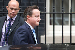 © Licensed to London News Pictures. 09/01/2013. London, UK. The British Prime Minister David Cameron is seen on Downing Street in London today (09/01/13) as he leaves for Prime Ministers Questions in Parliament. Photo credit: Matt Cetti-Roberts/LNP
