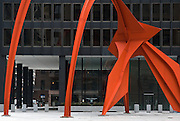 Chicago, Illinois, April, 2008-The American artist Alexander Calder's Flamingo sculpture outside the Ludwig Mies van der Rohe-designed Kluczynski Federal Building.