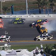 Daniel Suarez (19), Jimmie Johnson (48), William Byron (24) and Erik Jones (20) collide betweens turns 3 and 4 during the 60th Annual NASCAR Daytona 500 auto race at Daytona International Speedway on Sunday, February 18, 2018 in Daytona Beach, Florida.  (Alex Menendez via AP)