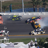 Daniel Suarez (19), Jimmie Johnson (48), William Byron (24) and Erik Jones (20) collide betweens turns 3 and 4 during the 60th Annual NASCAR Daytona 500 auto race at Daytona International Speedway on Sunday, February 18, 2018 in Daytona Beach, Florida.  (Alex Menendez via AP)
