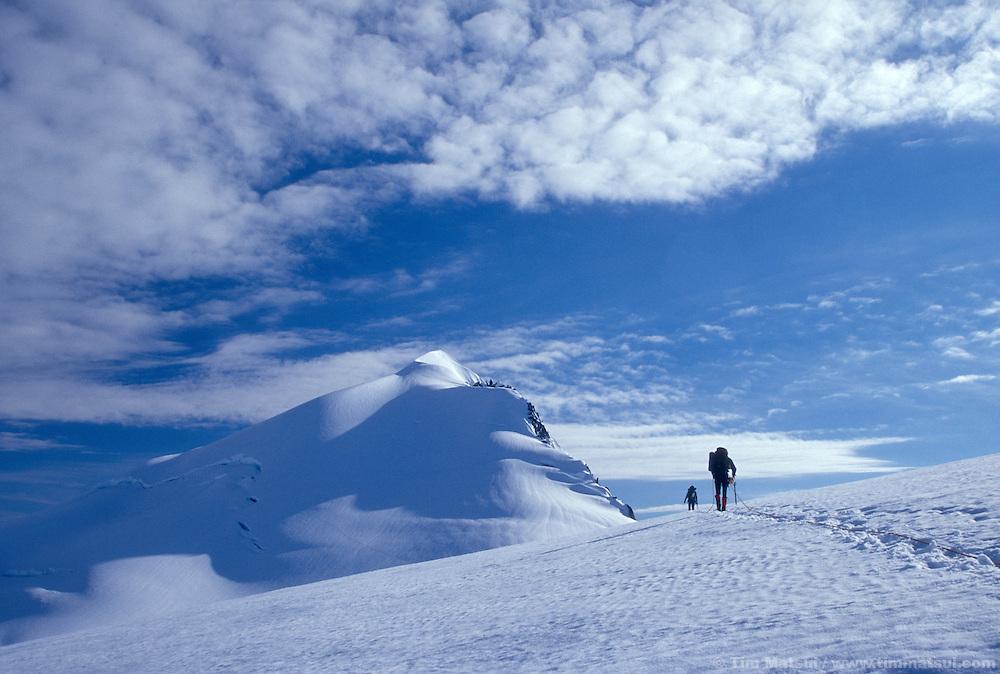 Traversing the Inspiration Glacier below the summit of Eldorado in the North Cascades National Park.