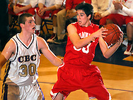 5 FEB. 2010 -- TOWN AND COUNTRY, MO. --   Chaminade Prep's Giovanni Ferrara (33, CQ) hauls in a reboudn in front of CBC High School's Ryan Pierson (30) during the game between CBC and Chaminade at CBC High School in Town and Country, Mo. Friday, Feb. 5, 2010. Photo (c) copyright by Sid Hastings.