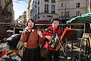 Christian Bassoul, accordionist, playing and singing traditional French songs with a second female singer, at Le Petit Bal de la Rue Mouffetard, a street music session held every Sunday morning, encouraging passersby to sing along and dance, at the Place Georges Moustaki, in the 5th arrondissement of Paris, France. Photographed on 17th February 2019 by Manuel Cohen