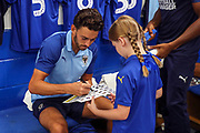 AFC Wimbledon defender Will Nightingale (5) and Mascot during the EFL Sky Bet League 1 match between AFC Wimbledon and Rotherham United at the Cherry Red Records Stadium, Kingston, England on 3 August 2019.