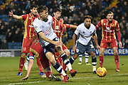 Bury Defender, Will Aimson (4) shoots during the EFL Sky Bet League 2 match between Bury and Milton Keynes Dons at the JD Stadium, Bury, England on 12 January 2019.