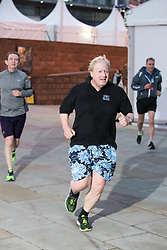© Licensed to London News Pictures  . 03/10/2017 . Manchester , UK . Foreign Secretary BORIS JOHNSON goes for an early jog at the start of day three of the Conservative Party Conference at the Manchester Central Convention Centre . Photo credit : Joel Goodman/LNP