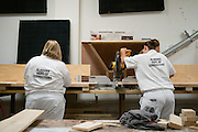 "COLUMBIANA, AL – JUNE 25, 2015: <br /> Female residents learn carpentry skills in the wood shop at the Alabama Therapeutic Education Facility. <br /> The Alabama Therapeutic Education Facility in Columbiana, Alabama has operated under contract with the Department of Corrections since 2008. The facility represents an alternative to the state's overcrowded corrections facilities and an attempt to ""break the cycle of recidivism"" among inmates through a combination of positive messaging and educational opportunities. ""We're more focused on changing behavior than controlling it,"" said Gary Hetzel, director of the facility. <br />  ATEF is owned and operated by Community Education Centers, a ""reentry treatment and education services provider"" based in New Jersey that is currently operating in 16 states. In stark contrast to most medium custody prisons, ATEF is air conditioned, and each room boasts a telephone and private bath. Post-secondary education is offered to all ""residents"" who are then required to have a GED before leaving the facility. Correctional Officers, called ""operations counselors"" lead residents in vocational training and certification opportunities through partnership with the local J.F. Ingram Community College. The facility also provides specific anger and stress management programs when prescribed by judges on a case by case basis. <br /> But not all inmates are given the opportunity to serve time at ATEF. The Alabama Department of Corrections makes a determination of eligibility upon sentencing based on the severity of a crime, and most ATEF ""residents"" are int the final stages of a sentence and preparing for work release.<br /> ""It generally takes 4-6 weeks for DOC inmate who gets transferred here to adjust to the place,"" said Gary Hetzel, director of the facility.""Some residents say the place saved their life."" Currently ATEF is the only facility of its kind run in the state of Alabama.<br /> CREDIT: Bob Miller for The Daily Signal"