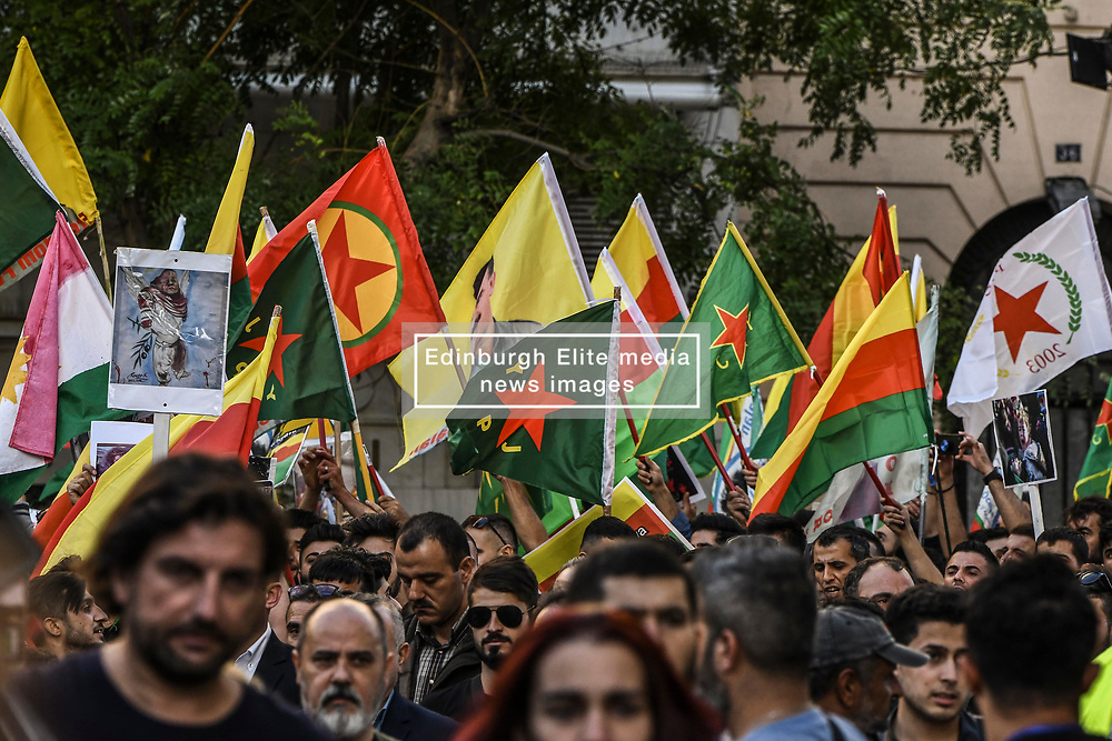 "Kurds living in Greece chant slogans during a protest near the Turkish embassy in Athens, on October 12, 2019. Turkey launched an assault on Kurdish forces in northern Syria with air strikes and explosions reported along the border. President Recep Tayyip Erdogan announced the start of the attack on Twitter, labelling it ""Operation Peace Spring"".<br /> <br /> Pictured: <br /> Dimitris Lampropoulos  