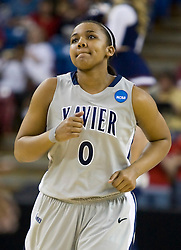 March 27, 2010; Sacramento, CA, USA; Xavier Musketeers guard Tyeasha Moss (0) during the first half against the Gonzaga Bulldogs in the semifinals of the Sacramental regional in the 2010 NCAA womens basketball tournament at ARCO Arena.  Xavier defeated Gonzaga 74-56.