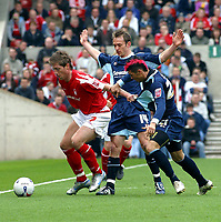 Photo: Dave Linney.<br />Nottingham Forest v Bournemouth. Coca Cola League 1. 29/04/2006.Forest's Gary Holt(L) gets in some shirt tugging with   Callum Hart