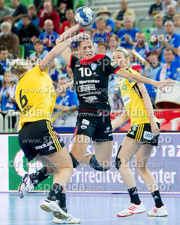 Andjela Bulatovic #10 of RK Krim Mercator during handball match between RK Krim Mercator (SLO) and  IK Sävehof (SWE) of 1st Round of Women's Champions League on October 5, 2013 in Arena Stozice, Ljubljana, Slovenia. (Photo by Urban Urbanc / Sportida.com)