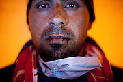 Tunis, Tunisia. January 27th 2011.A protester sewed his lips.He is one of the protesters who spent four nights (in defiance of a curfew) in front of the Prime Minister's office (Mohammed Ghannouchi) on the Kasbah Square. They demand the removal of Mohammed Ghannouchi and members of the ousted president's regime (Zine El Abidine Ben Ali) still in the the government. .....