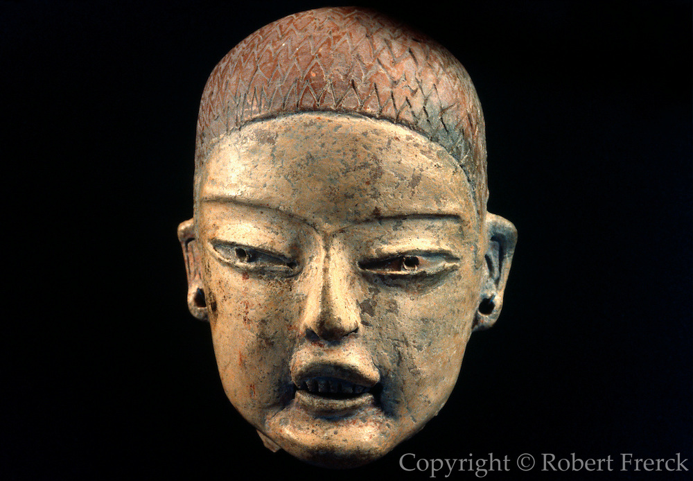 MEXICO, MEXICO CITY MUSEUM Olmec; ceramic head with teeth