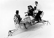 David Kirke, Tim Hunt, Nicky Slade  and Lord Xan Rufus Isaacs going down on dining table, Dangerous Sports Club ski race. St. Moritz. 1983.<br />© Copyright Photograph by Dafydd Jones<br />66 Stockwell Park Rd. London SW9 0DA<br />Tel 0171 733 0108