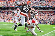 Sept. 19, 2010; Cleveland, OH, USA; Cleveland Browns tight end Benjamin Watson (82) jumps over Kansas City Chiefs cornerback Brandon Flowers (24) during the first quarter at Cleveland Browns Stadium. Mandatory Credit: Jason Miller-US PRESSWIRE