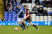 Birmingham City midfielder Andrew Shinnie watches Bournemouth midfielder Eunan O'Kane during the The FA Cup third round match between Birmingham City and Bournemouth at St Andrews, Birmingham, England on 9 January 2016. Photo by Alan Franklin.