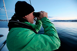 NORWAY TROMSO 5DEC15 - Greenpeace campaigner Christian Bussau of Germany during whale observations in Kvalsoya Sound near the arctic city of Tromso.<br /> <br /> jre/Photo by Jiri Rezac / Greenpeace<br /> <br /> © Jiri Rezac 2015