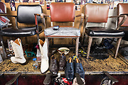 Shoe shine stations seen at P & G Shoe Shine & Apparel in the Auburn Gresham neighborhood of Chicago.