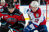 KELOWNA, BC - NOVEMBER 26:  Alex Swetlikoff #17 of the Kelowna Rockets is checked by Liam Keeler #12 of the Edmonton Oil Kings during first period at Prospera Place on November 26, 2019 in Kelowna, Canada. (Photo by Marissa Baecker/Shoot the Breeze)