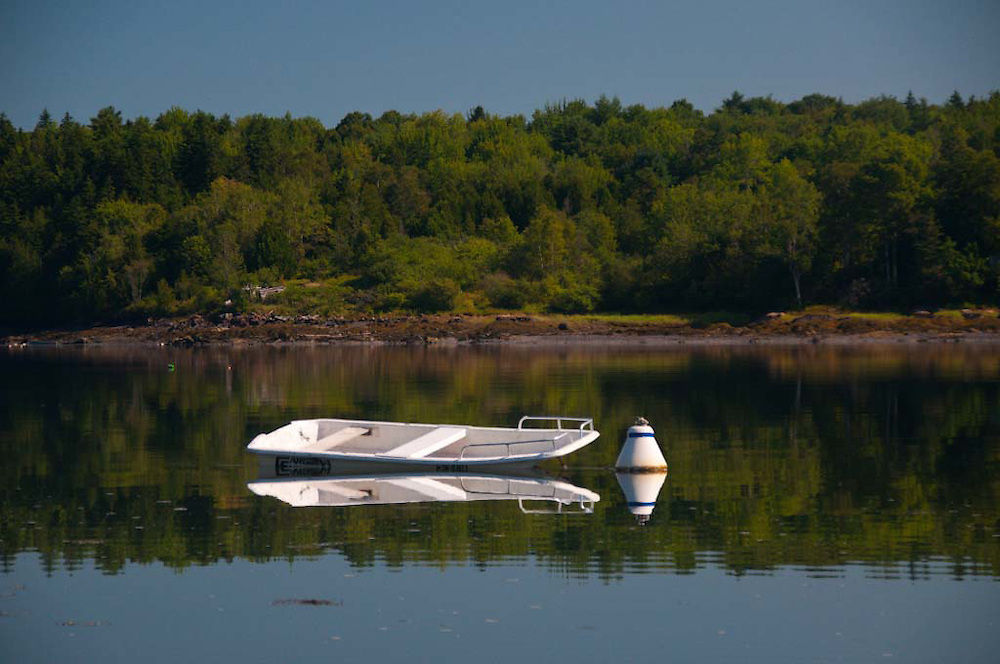 Skiff Turned Dinghy in the Bagaduce River at Upper Negro Island, Castine, Maine, US