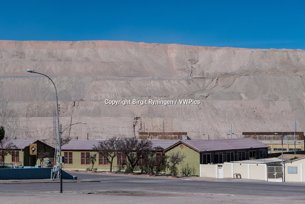 Chuquicamata town, once a thriving company town with banks, restaurants and playgrounds, but which has since been evacuated due to legal and health issues. Today, parts of the city is burried under dross from the copper mine of same name.  Atacama, Chile