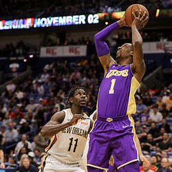 Mar 22, 2018; New Orleans, LA, USA; Los Angeles Lakers guard Kentavious Caldwell-Pope (1) shoots over New Orleans Pelicans guard Jrue Holiday (11) during the first quarter at the Smoothie King Center. Mandatory Credit: Derick E. Hingle-USA TODAY Sports