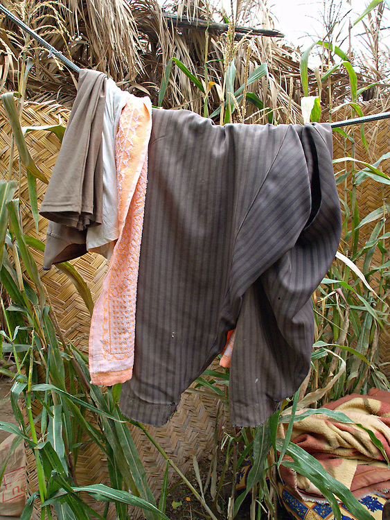 Dec15th 2003.ad Dawr, Iraq..Saddams hideout..In the yard of the farmhouse in which Saddam spent his last days before capture by US forces his clothes still hang on the laundry line.