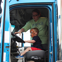A child gets behind the wheel of a diesel at Amory Main Street's touch-a-truck Friday during the festival.