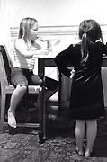 Two little girls eating at a table Newport South Wales