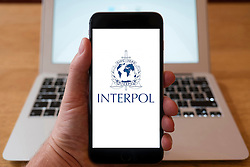 Using iPhone smartphone to display logo of Interpol