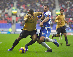 Wigan, England - Sunday, January 21, 2007: Everton's Victor Anichebe is brought down for a penalty by Wigan Athletic's David Unsworth during the Premier League match at the JJB Stadium. (Pic by David Rawcliffe/Propaganda)