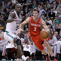 06 March 2012: Houston Rockets point guard Goran Dragic (3) drives past Boston Celtics power forward Kevin Garnett (5) during the Boston Celtics 97-92 (OT) victory over the Houston Rockets at the TD Garden, Boston, Massachusetts, USA.