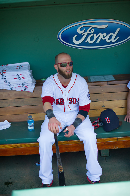 BOSTON, MA - JUNE 09: Dustin Pedroia #15 of the Boston Red Sox looks on from the dugout during the game against the Los Angeles Angels at Fenway Park in Boston, Massachusetts on June 9, 2013. (Photo by Rob Tringali) *** Local Caption *** Dustin Pedroia