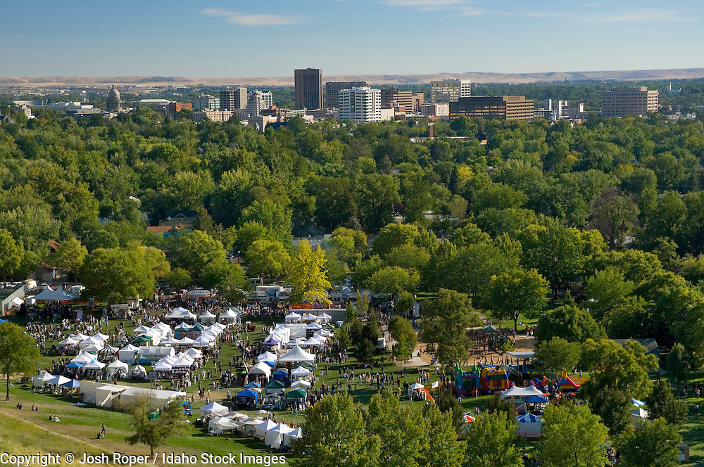 Idaho, Boise. The Hyde Park Street Fair at Camel's Back Park with the Boise skyline on a beautiful day.