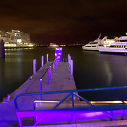 The Ferry Terminal at Auckland Harbour at night time, showing the Hilton Hotel in the background. Auckland, North Island, New Zealand, 25th November 2010. Photo Tim Clayton